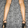 Female legs in heels. - Stock Photo