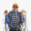 Man wrapped in cables. - Foto Stock