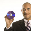 Man holding compact disc. — Stock Photo