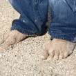 Male feet on beach. - Stock Photo
