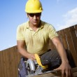 Construction Worker Sawing Wood — Stock Photo