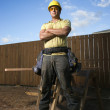 Male Construction Worker Stands with Folded Arms — Stock Photo