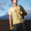 Construction Worker with Bolt Cutters and Chain — Stock Photo