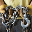 Gloved Hands Holding a Chain — Stock Photo