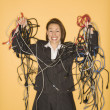 Businesswoman with cables. — Stock Photo
