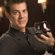 Man drinking red wine. — Stock Photo