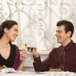 Couple toasting glasses. — Stock Photo