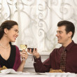 Stock Photo: Couple toasting glasses.