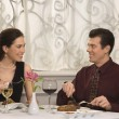 Stock Photo: Couple dining at restaurant.