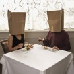 Couple wearing bags. — Stock Photo