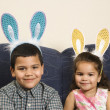 Kids wearing bunny ears. - Foto de Stock  