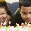 Kids and birthday cake. - Stock Photo