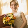 Girl holding flowers. — Stock Photo #9553446