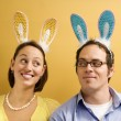 Couple wearing rabbit ears. — Stock Photo