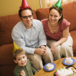 Family eating birthday cake. — Stock Photo