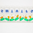Pills in Open Pill Organizer. Isolated - Stock Photo