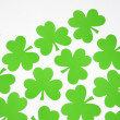 Green paper shamrocks. — Stock Photo #9553820