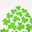 Green paper shamrocks. — Stock Photo #9553826