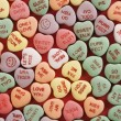 Candy hearts on red. — Stock Photo