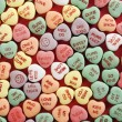 Candy hearts on red. - Stock Photo