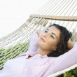 Woman in hammock. - Stock Photo