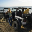 Woman with SUV at the Beach - Foto de Stock  
