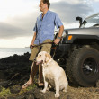 Man and Dog by SUV at the Beach — Stock Photo