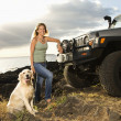 Woman and Dog by SUV at the Beach - Stock Photo