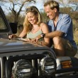 Stock Photo: Couple With Map on Car Hood