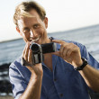 Stock Photo: Smiling MWith Video Camera