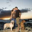 Kissing Couple With Dogs at the Beach — Stock Photo