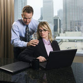 Businessman Annoying Businesswoman — Stockfoto
