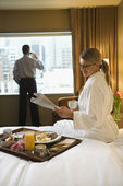 Woman and Man in Hotel Room — ストック写真