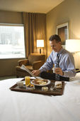 Businessman with Hotel Room Service — Foto de Stock