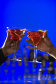 Toasting Cocktails in Martini Glasses — Stock Photo