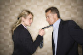 Angry Businesswoman Pulling Man's Tie — Stock Photo