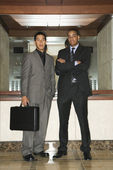 Two Businessmen Standing in Lobby — Stock Photo