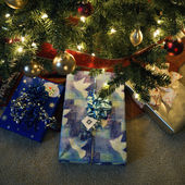 Christmas presents under tree. — Stock Photo