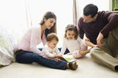 Mother, father and children. — Stock Photo