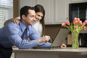 Couple with laptop. — Stockfoto