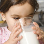 Girl drinking milk. — Stock Photo