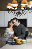 Couple in kitchen. — Stock Photo