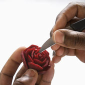 Hands carving beet. — Stock Photo