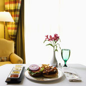 Room service with burger. — Stock Photo