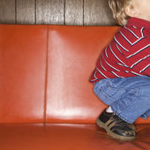 Boy on sofa. — Stock Photo