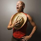 Man holding straw hat. — Stock Photo