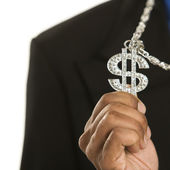 Man wearing money sign. — Stock Photo