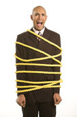 Businessman tied in rope. — Stock Photo