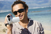 Man with video camera. — Stock Photo