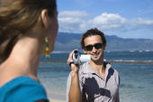 Couple with video camera. — Stock Photo